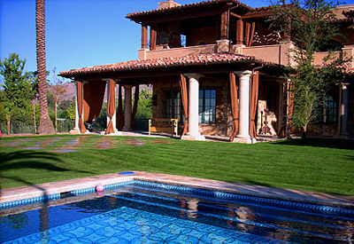 backyard with a pool and fresh sod from Evergreen Turf